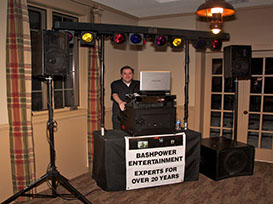 Photo of DJ Shawn and his equipment setup at an event